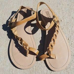 Lightly worn brown sandals